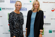 (L-R)  Caroline Wozniacki and Maria Sharapova pose for a photo prior to a press conference for the BNP Paribas Showdown on March 5, 2012 at the Essex House in New York City.