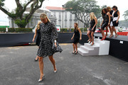 (L-R) Maria Sharapova of Russia, Angelique Kerber of Germany,  Simona Halep of Romania, Petra Kvitova of Czech Republic, Lucie Safarova of Czech Republic, Agnieszka Radwanska of Poland, Garbine Muguruza of Spain and  Flavia Pennetta of Italy attend the official photo shoot for the BNP Paribas WTA Finals at the Old Supreme Court Building on October 23, 2015 in Singapore.
