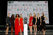 Kiki Bertens of the Netherlands, Sloane Stephens of the United States, Naomi Osaka of Japan, Angelique Kerber of Germany, Caroline Wozniacki of Denmark, Petra Kvitova of the Czech Republic, Elina Svitolina of the Ukraine, and Karolina Pliskova of the Czech Republic pose on stage with the Billy Jean King Trophy during the Official Draw Ceremony and Gala of the BNP Paribas WTA Finals Singapore presented by SC Global at Marina Bay Sands Hotel on October 19, 2018 in Singapore.