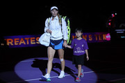 Caroline Wozniacki of Denmark walks onto the court prior to her singles match against Elina Svitolina of the Ukraine during day 5 of the BNP Paribas WTA Finals Singapore presented by SC Global at Singapore Sports Hub on October 25, 2018 in Singapore.