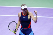 Caroline Wozniacki of Denmark reacts to a point in her singles match against Elina Svitolina of the Ukraine during day 5 of the BNP Paribas WTA Finals Singapore presented by SC Global at Singapore Sports Hub on October 25, 2018 in Singapore.