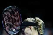 Angelique Kerber of Germany celebrates match point in her women's singles match against Naomi Osaka of Japan during day 4 of the BNP Paribas WTA Finals Singapore presented by SC Global at Singapore Sports Hub on October 24, 2018 in Singapore. at Singapore Sports Hub on October 24, 2018 in Singapore.