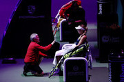 Caroline Wozniacki of Denmark speaks with her coach Piortr Wozniacki during a break in her singles match  with Petra Kvitova of the Czech Republic prior to their singles match during day 3 of the BNP Paribas WTA Finals Singapore presented by SC Global at Singapore Sports Hub on October 23, 2018 in Singapore.  at Singapore Sports Hub on October 23, 2018 in Singapore.