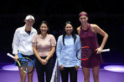 Caroline Wozniacki of Denmark poses for a photo with Petra Kvitova of the Czech Republic prior to their singles match during day 3 of the BNP Paribas WTA Finals Singapore presented by SC Global at Singapore Sports Hub on October 23, 2018 in Singapore.  at Singapore Sports Hub on October 23, 2018 in Singapore.