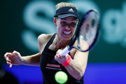 Angelique Kerber of Germany plays a forehand in her women's singles match against Naomi Osaka of Japan during day 4 of the BNP Paribas WTA Finals Singapore presented by SC Global at Singapore Sports Hub on October 24, 2018 in Singapore. at Singapore Sports Hub on October 24, 2018 in Singapore.