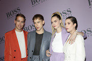 Peter Zurkuhlen, Tommy Dorfman, Cara Delevingne and Ashley Benson attend the BOSS fashion show during the Milan Fashion Week Fall/Winter 2020 - 2021 on February 23, 2020 in Milan, Italy.