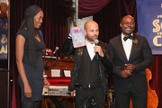 Keziah Jean, CEO, APJ David Belle and co-host Jimmy-Jean Louis speak on stage at BOVET 1822 & Artists for Peace and Justice Present Songs From The Cinema Benefit on March 3, 2018 in Los Angeles, California.