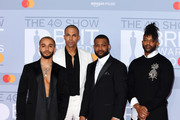 (EDITORIAL USE ONLY) (L to R) Aston Merrygold, Marvin Humes, JB Gill and Oritse Williams of JLS attend The BRIT Awards 2020 at The O2 Arena on February 18, 2020 in London, England.