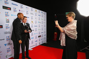 Clare Balding takes a photo of Thierry Henry as he poses with AP McCoy, winner of the Outstanding Contribution to Sport, sponsored by CWM Cyclong Promotions at the BT Sport Industry Awards 2015 at Battersea Evolution on April 30, 2015 in London, England. The BT Sport Industry Awards is the most prestigious commercial sports awards ceremony in Europe, where over 1750 of the industryÂ's key decision-makers mix with high profile sporting celebrities for the most important networking occasion in the sport business calendar.