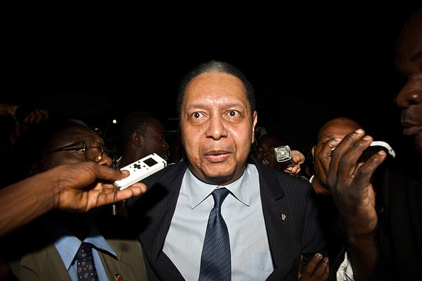 """Jean-Claude Duvalier (C), the former  Haitian leader """"Baby Doc"""", arrives at the airport on January  16, 2011 in Port-au-Prince, Haiti. Duvalier was greeted by supporters  upon returning to his homeland for the first time in 25 years from his  exile in France."""