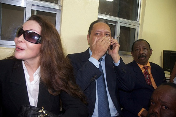 """Jean-Claude Duvalier (C), the former Haitian leader  """"Baby Doc"""", arrives at the airport with his wife Veronique Roy  (L) on January 16, 2011 in Port-au-Prince, Haiti. Duvalier was greeted  by supporters upon returning to his homeland for the first time in 25  years from his exile in France."""