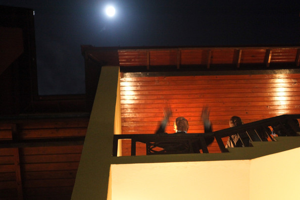 Jean-Claude Duvalier, the former Haitian leader known as  'Baby Doc', waves to the crowd from a balcony at Karibe  Hotel on January 16, 2011 in Port-au-Prince, Haiti. Duvalier was  greeted by supporters upon returning to his homeland for the first time  in 25 years from his exile in France.