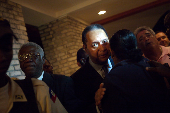 Jean-Claude Duvalier, the former Haitian leader known as  'Baby Doc', makes his way through the Karibe Hotel on January 16, 2011  in Port-au-Prince, Haiti. Duvalier was greeted by supporters upon  returning to his homeland for the first time in 25 years from his exile  in France.