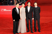 "Actors Zhang Guo Li, Xu Fan, Adrien Brody and director Feng Xiaogang attend the ""Back To 1942"" Premiere during the 7th Rome Film Festival at the Auditorium Parco Della Musica on November 11, 2012 in Rome, Italy."