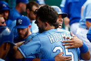 Salvador Perez #13 of the Kansas City Royals is congratulated by Eric Hosmer #35 in the dugout after scoring during the 4th inning of the game against the Baltimore Orioles at Kauffman Stadium on August 27, 2015 in Kansas City, Missouri.