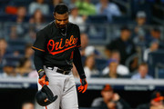 Adam Jones #10 of the Baltimore Orioles reacts after striking out in the first inning against the New York Yankees at Yankee Stadium on September 21, 2018 in the Bronx borough of New York City.