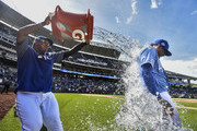 Meibrys Viloria (R)  of the Kansas City Royals is doused with water by Salvador Perez as they celebrate a 9-1 win over the Baltimore Orioles at Kauffman Stadium on September 2, 2018 in Kansas City, Missouri.