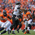 Joe Flacco Photos - Quarterback Joe Flacco #5 of the Baltimore Ravens is hit by linebacker DeMarcus Ware #94 of the Denver Broncos in the second quarter of a game at Sports Authority Field at Mile High on September 13, 2015 in Denver, Colorado. - Baltimore Ravens v Denver Broncos