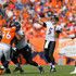 Joe Flacco Photos - Quarterback Joe Flacco #5 of the Baltimore Ravens passes for a first down against the Denver Broncos in the third quarter of a game at Sports Authority Field at Mile High on September 13, 2015 in Denver, Colorado. - Baltimore Ravens v Denver Broncos