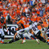 Cornerback Aqib Talib #21 of the Denver Broncos returns an interception of a pass intended for wide receiver Steve Smith #89 of the Baltimore Ravens for a touchdown in the third quarter of a game at Sports Authority Field at Mile High on September 13, 2015 in Denver, Colorado.