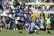Chris Ivory #33 of the Jacksonville Jaguars is tackled by Eric Weddle #32 of the Baltimore Ravens during an NFL game on September 25, 2016 at EverBank Field in Jacksonville, Florida. The Ravens defeated the Jaguars 19-17.