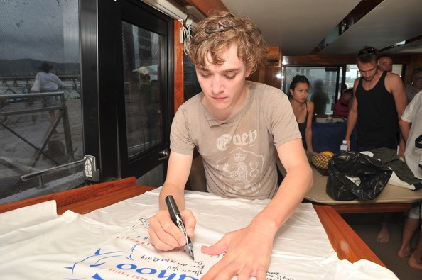 Actor Kyle Gallner, signs autographs for Wahoo Boat as part of the preparations ahead of the Bangkok International Film Festival 2009 at Chalong Bay on September 23, 2009 in Bangkok, Thailand.