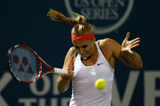 Sabine Lisicki of Germany plays against Kimiko Date-Krumm of Japan during day two of the Bank of the West Classic at the Stanford University Taube Family Tennis Stadium on August 4, 2015 in Stanford, California.