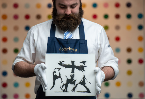 Colourful Exhibition Celebrating British Art At Sotheby's [piece,t-shirt,beard,facial hair,moustache,sleeve,top,illustration,banksy,art handler,weaponry,sale,front,sothebys,colourful exhibition celebrating british art,opens to public ahead of auctions,preview]