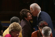 House Minority Leader Sen. Nancy Pelosi (D-CA) greets U.S. Vice President Joe Biden before U.S. President Barack Obama delivers the State of the Union address to a joint session of Congress in the House Chamber at the U.S. Capitol on January 28, 2014 in Washington, DC. In his fifth State of the Union address, Obama is expected to emphasize on healthcare, economic fairness and new initiatives designed to stimulate the U.S. economy with bipartisan cooperation.