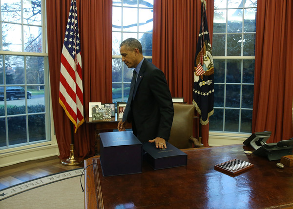 obama oval office. President Obama Signs Bills In The Oval Office Of White House