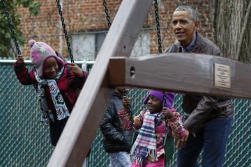 Barack Obama President Obama Plays With Children on a Swing Donated by the First Family at the Jobs Have Priority Shelter