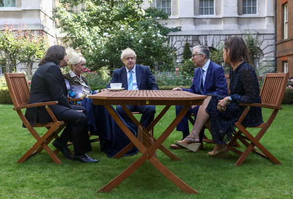 Prime Minister Meets With Dame Barbara Windsor At Downing Street [table,outdoor table,furniture,leisure,backyard,outdoor furniture,event,grass,patio,wood,meets,television actress,barbara windsor,prime minister,boris johnson,scott mitchell,tea,downing street,london,meeting]