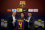 Cesc Fabregas (C) shows his new t-shirt surrounded by the Sport director Andoni Zubizarreta (L) and the FC Barcelona CEO Josep Maria Bartomeu during his presentation as the new signing for FC Barcelona at Camp Nou sports complex on August 15, 2011 in Barcelona, Spain.