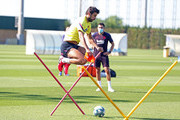 Gerard Pique of FC Barcelona jumps during a training session at Ciutat Esportiva Joan Gamper on May 23, 2020 in Barcelona, Spain. Spanish LaLiga clubs are back training in groups of up to 10 players following the LaLiga's 'Return to Training' protocols.