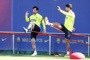 Lionel Messi and Luis Suarez of FC Barcelona work during a training session at Ciutat Esportiva Joan Gamper on May 19, 2020 in Barcelona, Spain. Spanish LaLiga clubs are back training in groups of up to 10 players following the LaLiga's 'Return to Training' protocols.
