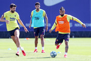 Arturo Vidal of FC Barcelona conducts the ball under pressure from Gerard Pique during a training session at Ciutat Esportiva Joan Gamper on May 23, 2020 in Barcelona, Spain. Spanish LaLiga clubs are back training in groups of up to 10 players following the LaLiga's 'Return to Training' protocols.