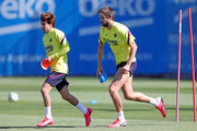Riqui Puig and Gerard Pique of FC Barcelona run during a training session at Ciutat Esportiva Joan Gamper on May 20, 2020 in Barcelona, Spain. Spanish LaLiga clubs are back training in groups of up to 10 players following the LaLiga's 'Return to Training' protocols.