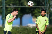 Lionel Messi and Dani Alves of FC Barcelona in action during a training session ahead of their UEFA Champions League Group F match against AFC Ajax at Ciutat Esportiva on October 20, 2014 in Barcelona, Spain.