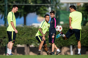 Lionel Messi (L) and Dani Alves (C) and Xavi Hernandez of FC Barcelona in action during a training session ahead of their UEFA Champions League Group F match against AFC Ajax at Ciutat Esportiva on October 20, 2014 in Barcelona, Spain.