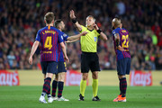 Match Referee Bjorn Kuipers speaks with Ivan Rakitic of Barcelona,Jordi Alba of Barcelona and Arturo Vidal of Barcelona  during the UEFA Champions League Semi Final first leg match between Barcelona and Liverpool at the Nou Camp on May 01, 2019 in Barcelona, Spain.