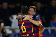 Lionel Messi of Barcelona is congratulated on scoring a goal with Dani Alves of Barcelona during the UEFA Super Cup between Barcelona and Sevilla FC at Dinamo Arena on August 11, 2015 in Tbilisi, Georgia.