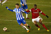 Andrea Orlandi of Brighton & Hove Albion beats Kelvin Etuhu of Barnsley during the npower Championship match between Barnsley and Brighton & Hove Albion at Oakwell Stadium on March 12, 2013 in Barnsley, England.