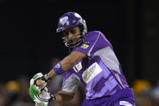 Shoaib Malik of the Hurricanes plays a shot during the Big Bash League match between Brisbane Heat and the Hobart Hurricanes at The Gabba on December 28, 2013 in Brisbane, Australia.