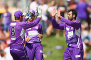 Shoaib Malik of the Hurricanes celebrates with team mates after taking the wicket of Daniel Hughes of the Thunder during the Big Bash League match between the Hobart Hurricanes and Sydney Thunder at Blundstone Arena on January 11, 2014 in Hobart, Australia.