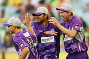 Shoaib Malik (C) of the Hurricanes celebrates with Cameron Boyce (L) and Ben Laughlin after catching out Matthew Wade of the Stars during the Big Bash League Semi Final match between the Melbourne Stars and the Hobart Hurricanes at Melbourne Cricket Ground on February 4, 2014 in Melbourne, Australia.