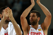 Felipe Reyes #9 of Spain and teammate Rudy Fernandez #5 celebrate after defeating Argentina 92-73 in a Men's Basketball Preliminary Round Group B game on Day 10 of the Rio 2016 Olympic Games at Carioca Arena 1 on August 15, 2016 in Rio de Janeiro, Brazil.