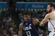 Paul George #13 of United States drives against Rudy Fernandez #5 of Spain during the Men's Semifinal match on Day 14 of the Rio 2016 Olympic Games at Carioca Arena 1 on August 19, 2016 in Rio de Janeiro, Brazil.