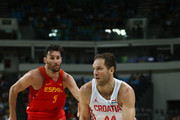 Bojan Bogdanovic #44 of Croatia drives the ball around Rudy Fernandez #5 of Spain during a Men's preliminary round basketball game between Croatia and Spain on Day 2 of the Rio 2016 Olympic Games at Carioca Arena 1 on August 7, 2016 in Rio de Janeiro, Brazil.