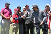 Entertainer Mark Wahlberg bumps fists with Hudson Feuerbacher during a trophy presentation for the Celebrity Shootout of the PGA TOUR Champions Bass Pro Shops Legends of Golf at Big Cedar Lodge on April 28, 2019 in Ridgedale, Missouri.