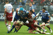 Zach Mercer of Bath is tackled by Courtney Lawes during the Gallagher Premiership Rugby match between Bath Rugby and Northampton Saints at the Recreation Ground on September 22, 2018 in Bath, United Kingdom.